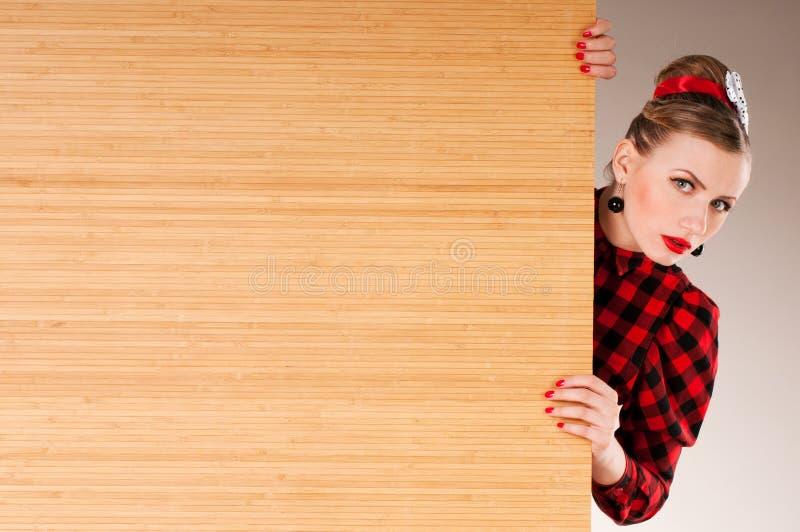 广告横幅标志-妇女激动的指向 图库摄影