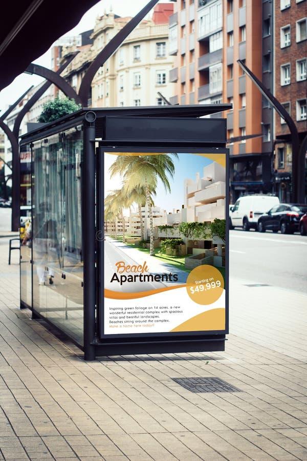 广告牌房地产在公共汽车站的海报广告 库存图片