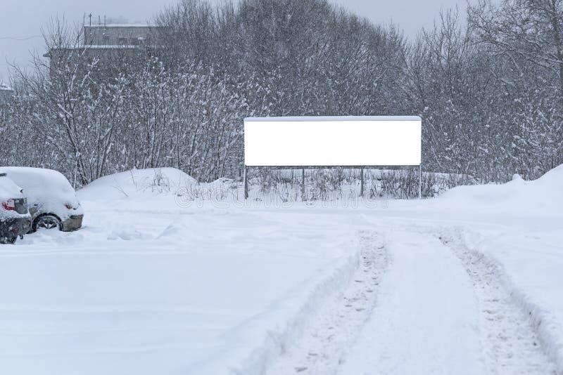 广告牌模板在冬天 库存图片