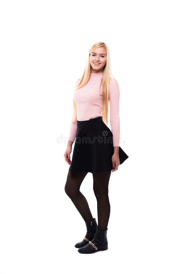 庄重装束的微笑反对白色背景的时髦少妇全长画象  图库摄影