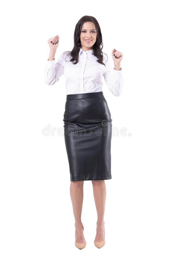 庆祝事业促进用被举的手的激动的愉快的年轻女商人 库存照片