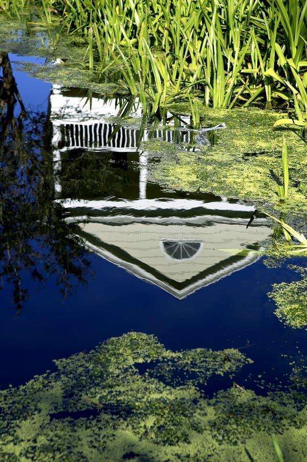 庆祝佛罗里达房子反射了状态团结的美国水 免版税库存图片