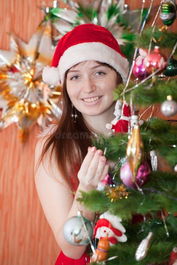 庆祝圣诞节的愉快的妇女 图库摄影