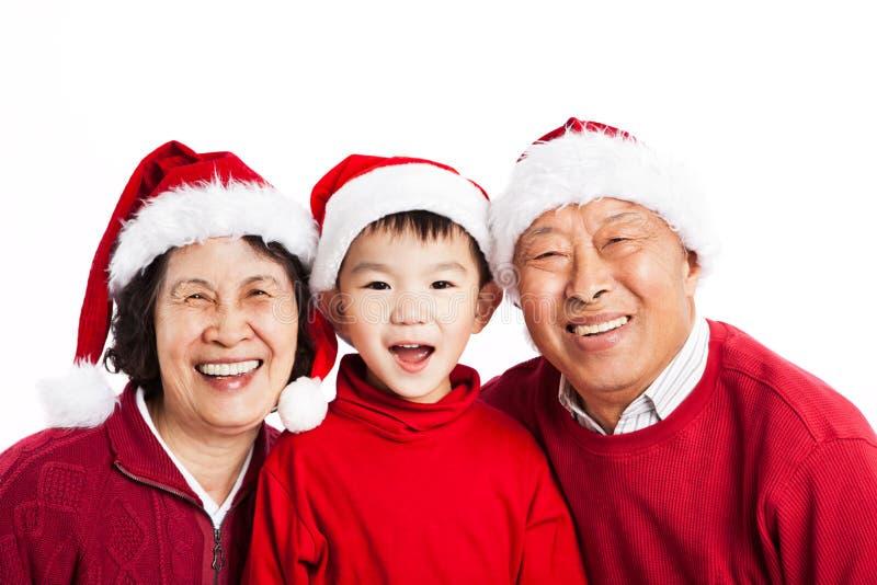 庆祝圣诞节祖父项的亚洲人 免版税库存照片