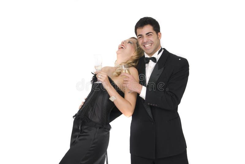 庆祝夫妇愉快的笑的当事人 免版税库存照片