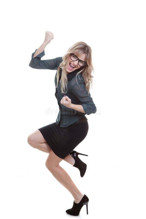 庆祝成功的女商人 免版税库存图片