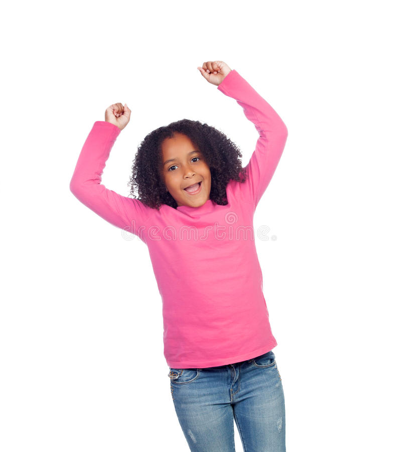 庆祝某事的小非洲女孩 免版税库存照片