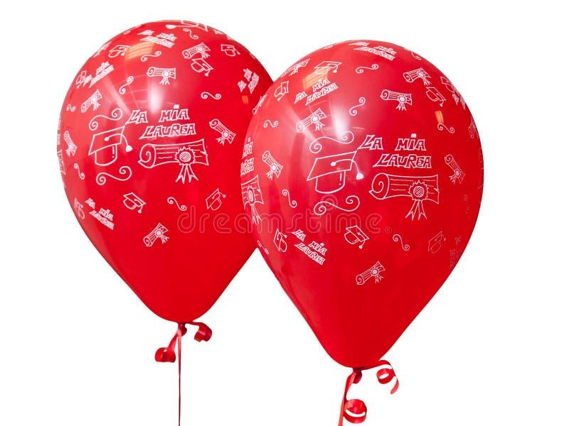 庆祝毕业典礼举行日的红色气球 免版税图库摄影