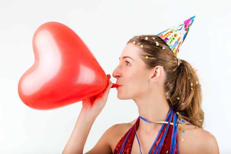 庆祝生日或情人节的妇女 库存照片
