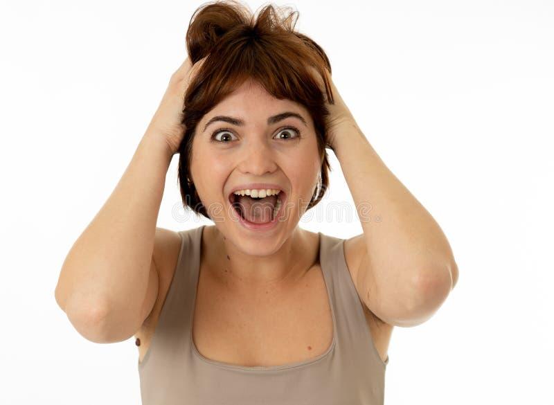 庆祝胜利和喜讯的惊奇的和愉快的妇女接近的画象  免版税库存图片