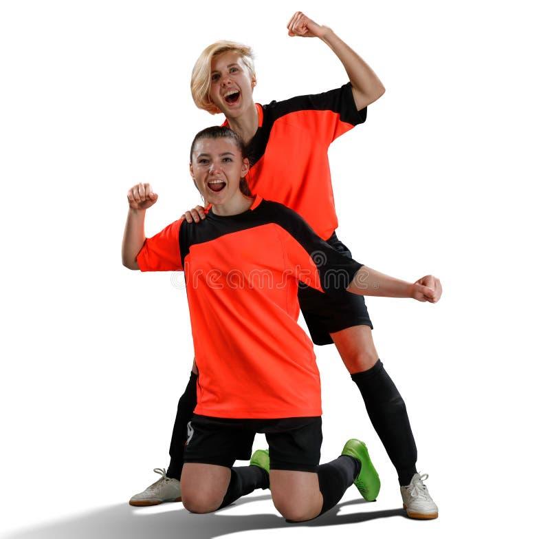 庆祝胜利的两位女性足球运动员被隔绝 免版税库存图片
