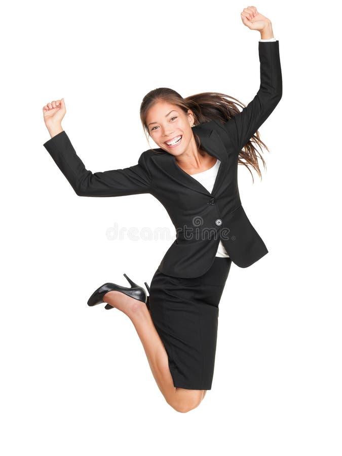 庆祝跳的女实业家 免版税库存图片