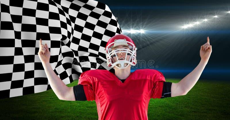庆祝他的胜利的美国橄榄球运动员反对方格的旗子 图库摄影