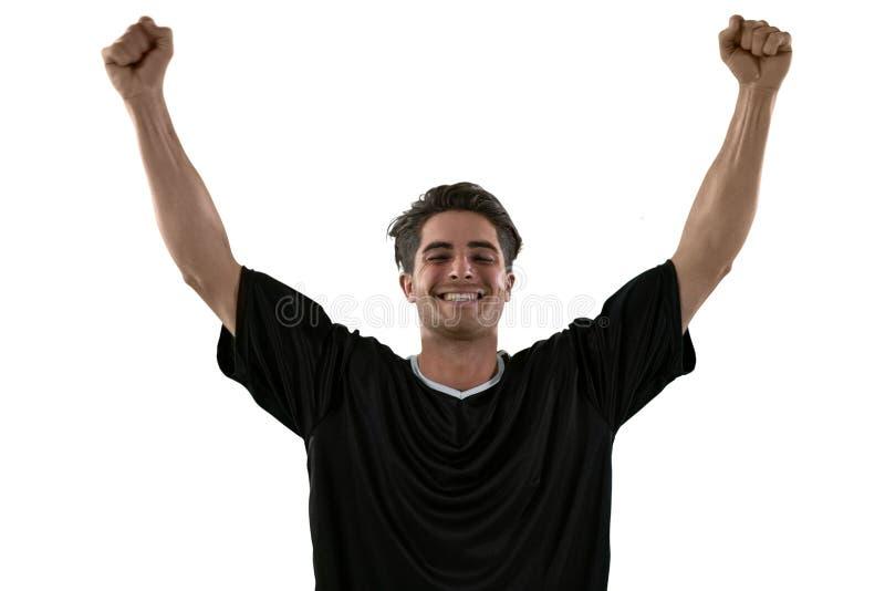 庆祝他的胜利的足球运动员 库存照片