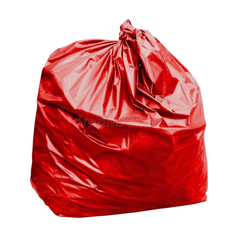 废物,与概念的红色垃圾袋塑料在白色背景是毒性危害的隔绝的红色垃圾袋的颜色 免版税库存图片
