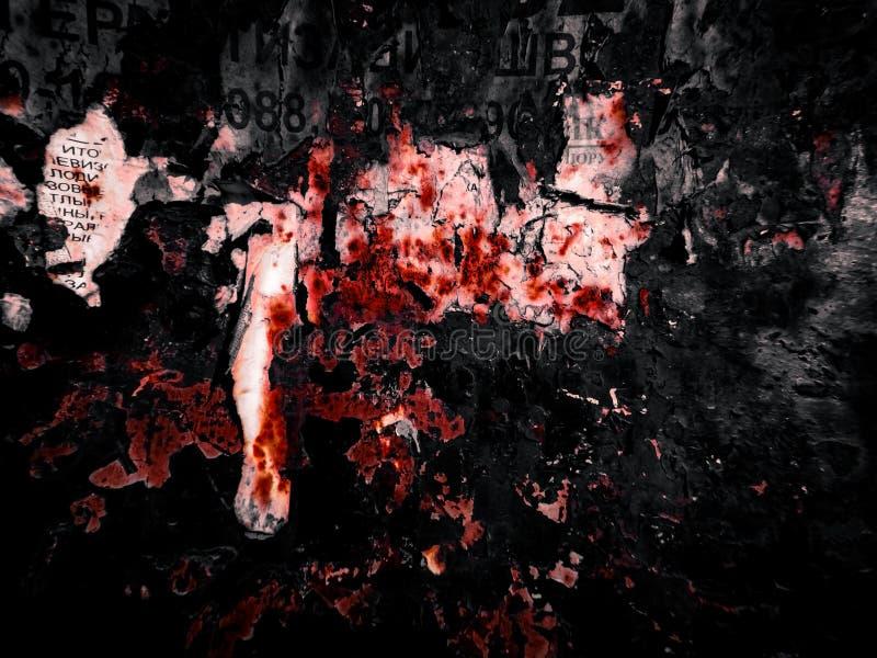 废纸在金属的在黑和红色 免版税图库摄影