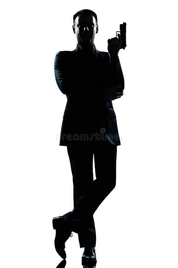 座席政券詹姆斯人姿势秘密剪影 免版税库存照片