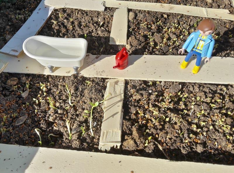 庭院玩具示范式样playmobil和木头 库存图片