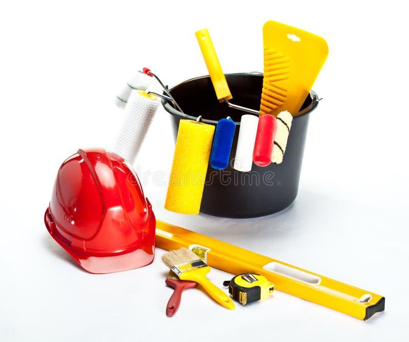 建筑安全帽绘画工具 免版税库存图片