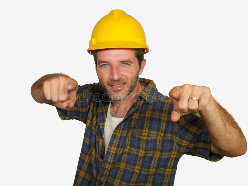 建筑工人-可爱和愉快的建造者人公司画象放松的安全帽微笑的确信摆在的 库存图片