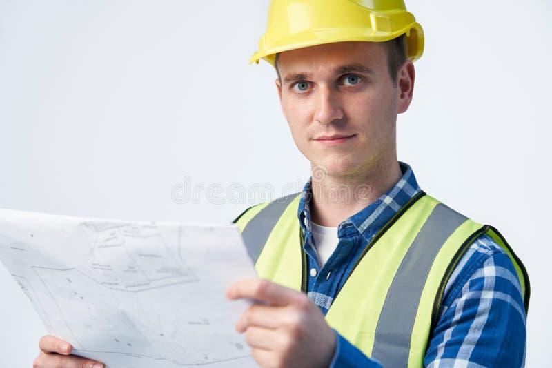 建筑师白色背景中的规划画像 免版税库存照片