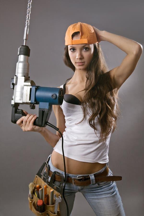 建筑性感的女工年轻人 免版税库存图片