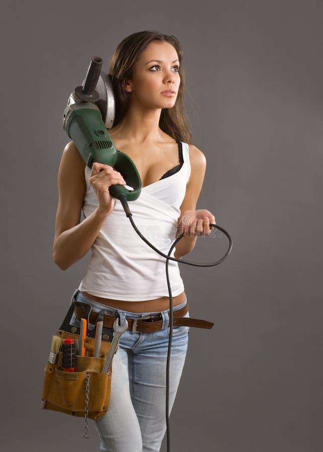 建筑性感的女工年轻人 图库摄影