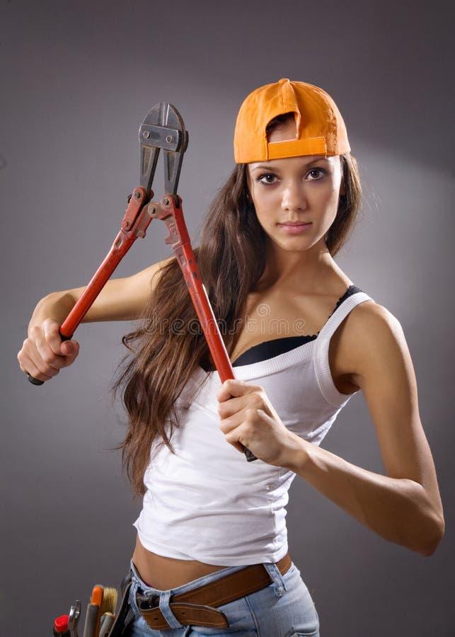 建筑性感的女工年轻人 库存图片