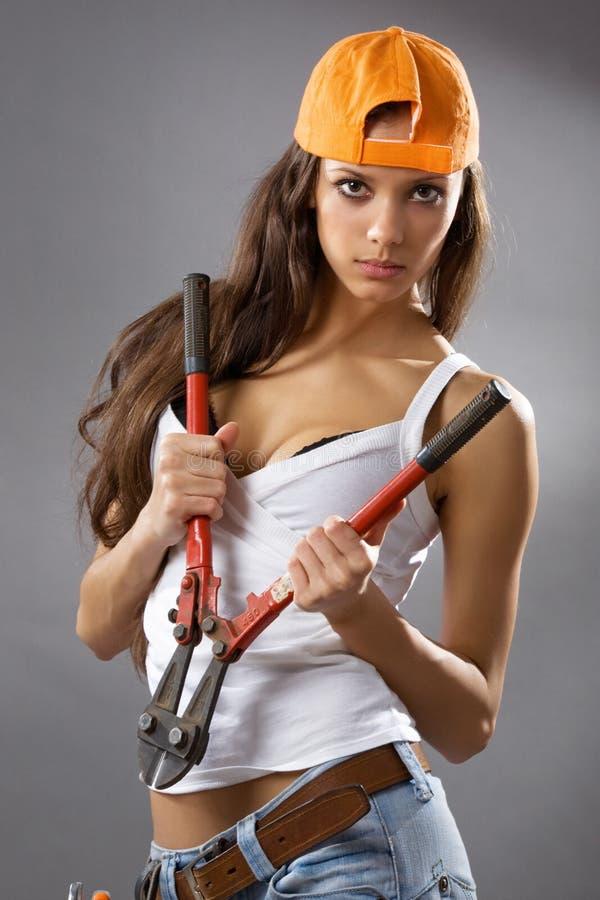 建筑性感的女工年轻人 免版税库存照片