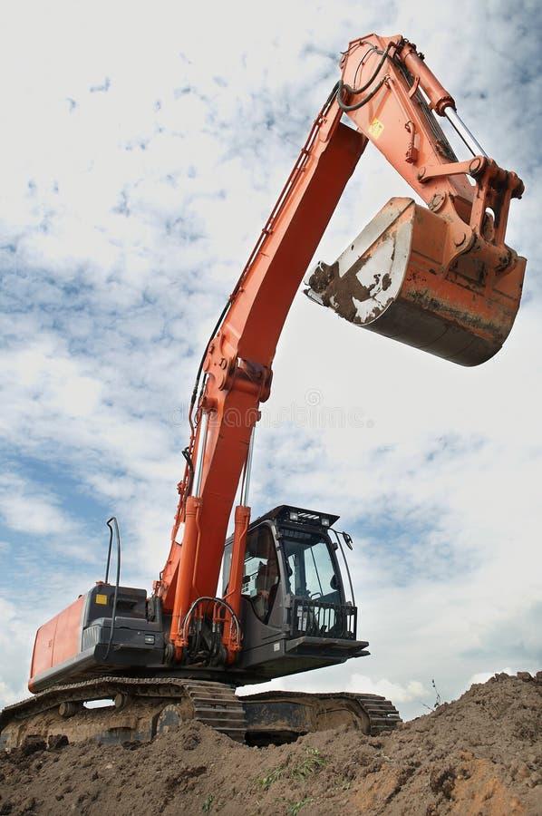 建筑挖掘机装入程序 免版税库存照片