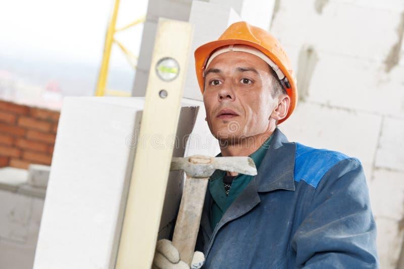 建筑泥工有级别的工作者砌砖工 图库摄影