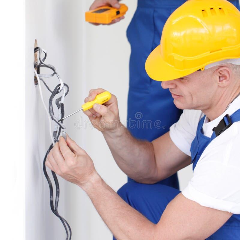 建造者与电一起使用 免版税库存照片