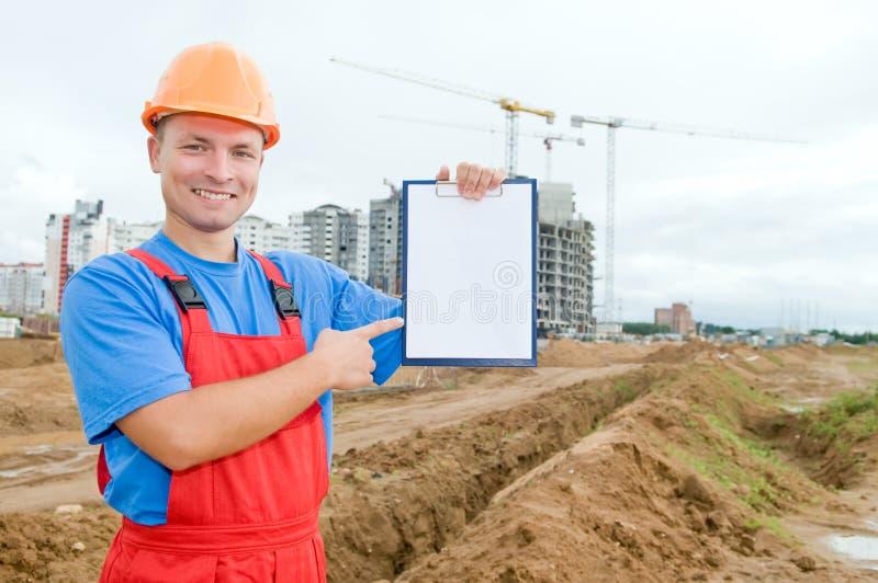 建造者剪贴板面带笑容 库存图片