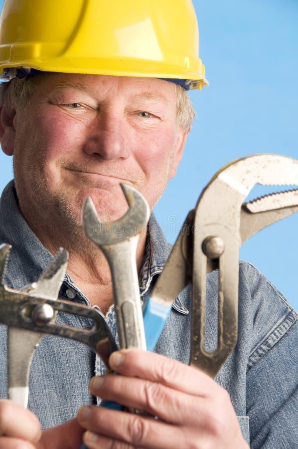建造者承包商愉快的微笑的工具 免版税库存照片