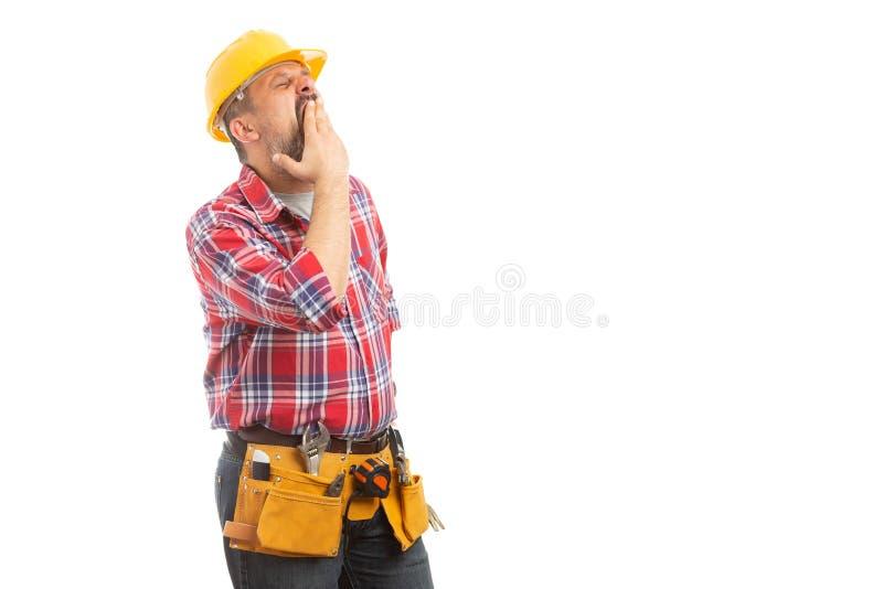 建造者覆盖物嘴,当打呵欠时 免版税库存图片