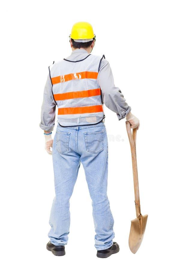 开掘与铁锹的背面图工作者 库存照片
