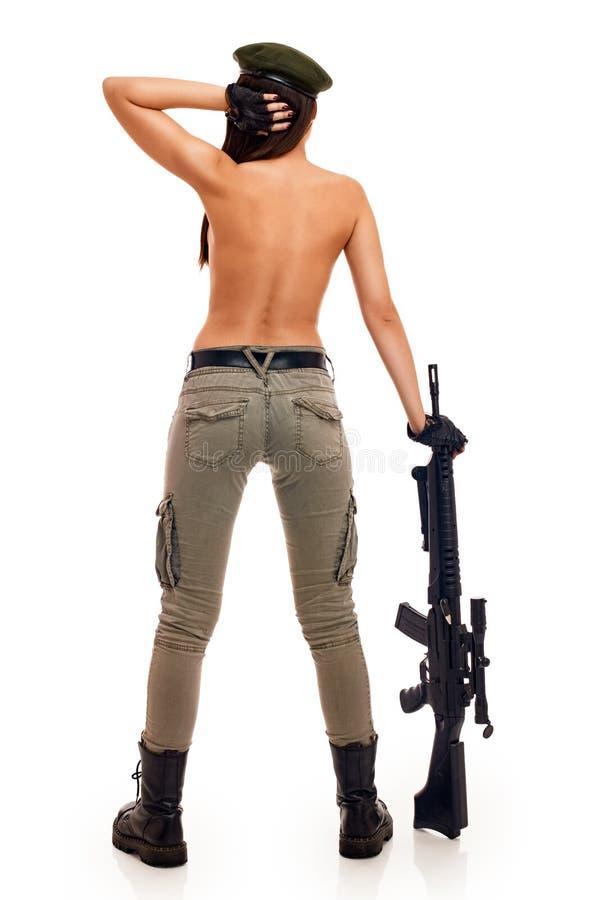 开枪性感的妇女 库存照片