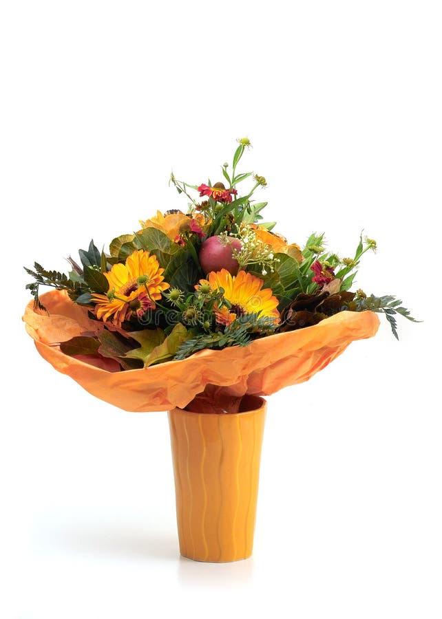 开花橙色花瓶 库存照片