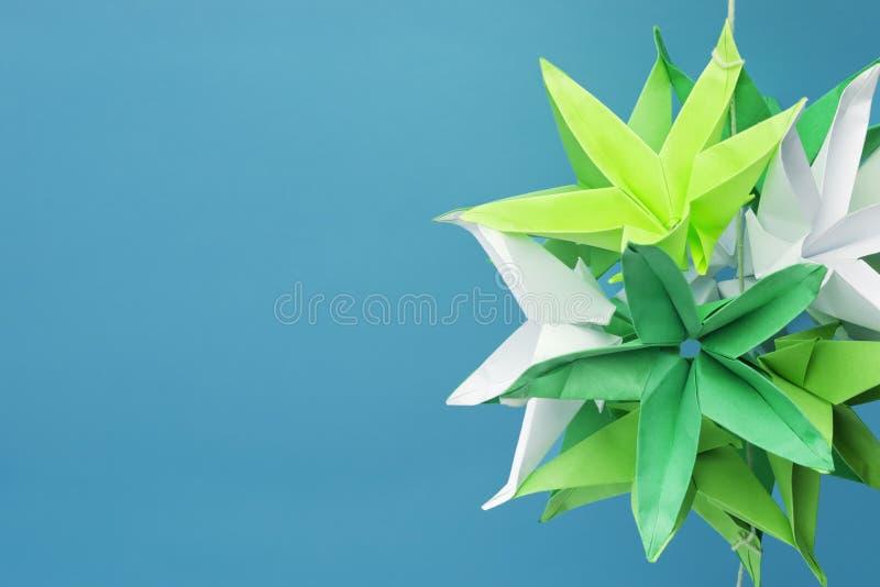 开花origami被塑造的星形 免版税库存照片