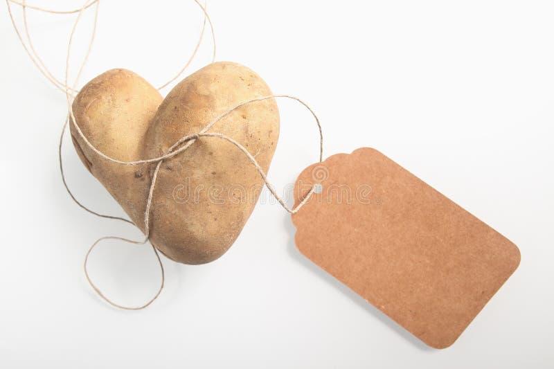 异常的双重心形的新鲜的土豆 图库摄影
