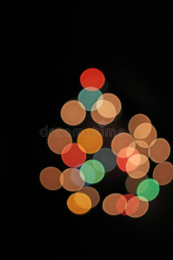 弄脏被弄脏的defocused圣诞灯bokeh光点 免版税库存照片