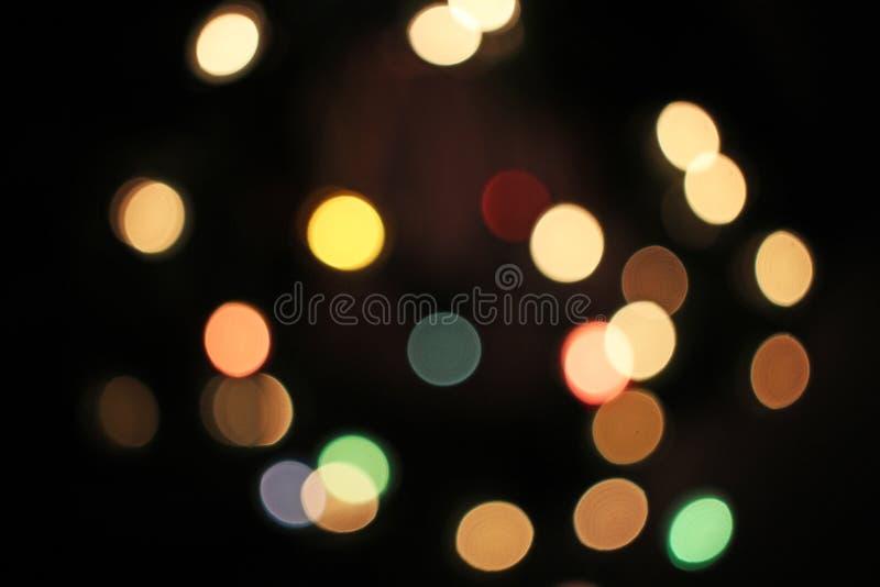 弄脏被弄脏的defocused圣诞灯bokeh光点 免版税库存图片
