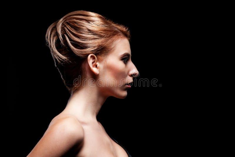 引诱的设计端视图与发型的 免版税库存照片