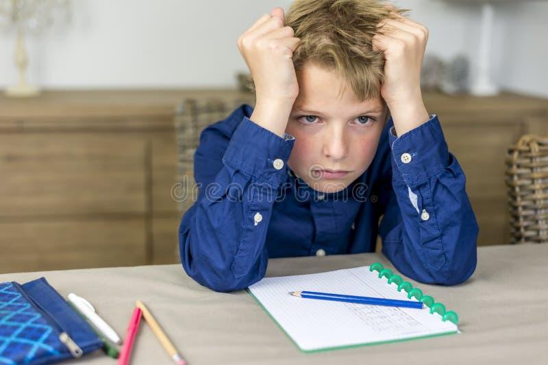 紧张家庭作业 免版税库存照片