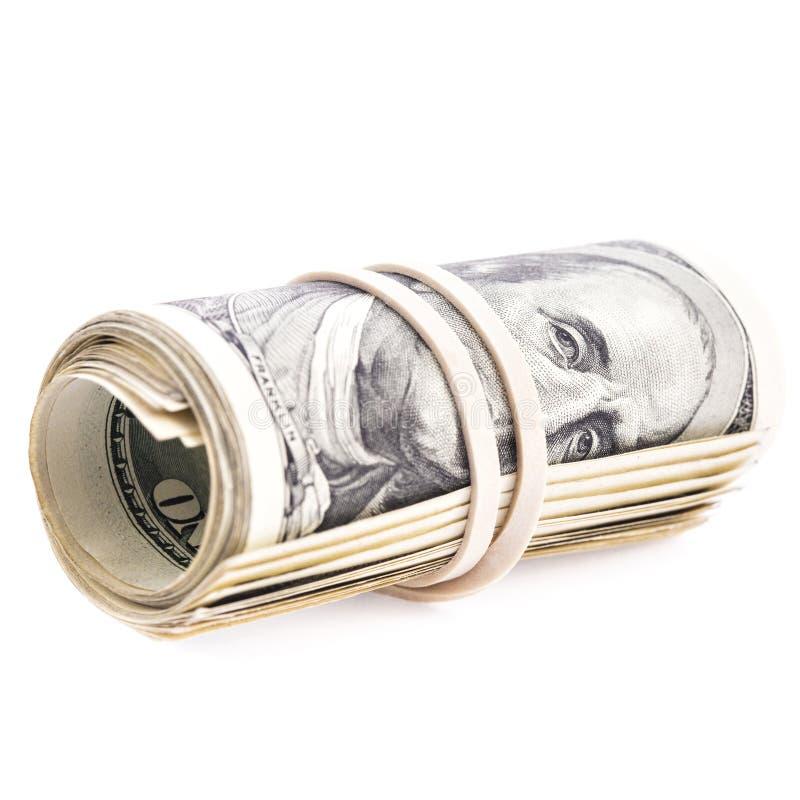 100张美元钞票卷起了并且拉紧了与橡胶禁令 库存照片