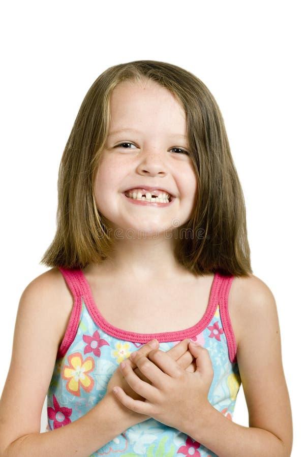 弯曲的女孩牙 免版税库存图片