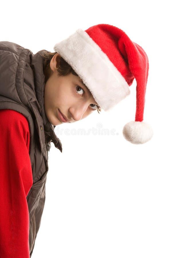 弯曲的男孩圣诞节  库存图片