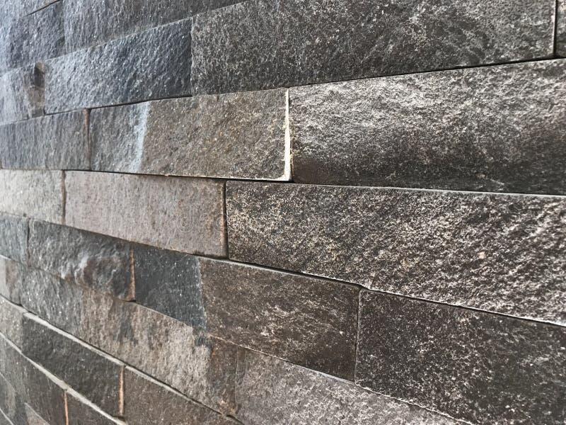 弯曲的石墙 免版税图库摄影