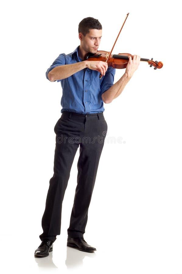 弹小提琴的人 免版税库存照片