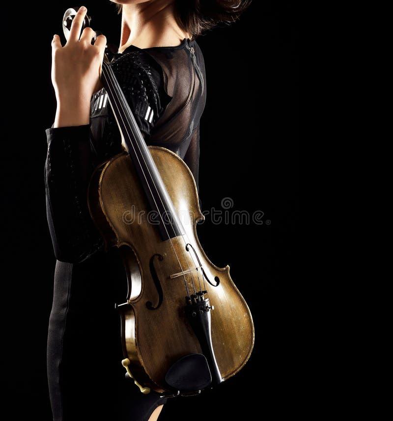 弹小提琴 免版税图库摄影